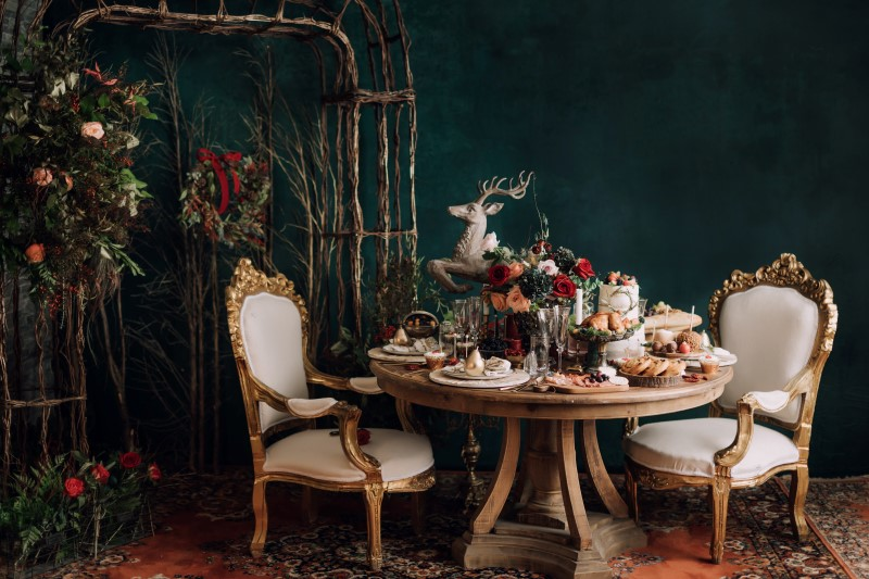 Culture Fusion food display, beautiful white chairs, reindeer statue on table,