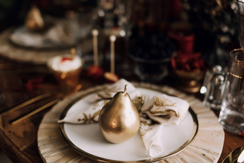 West Coast Weddings Magazine gold pear on white plate with gold rim