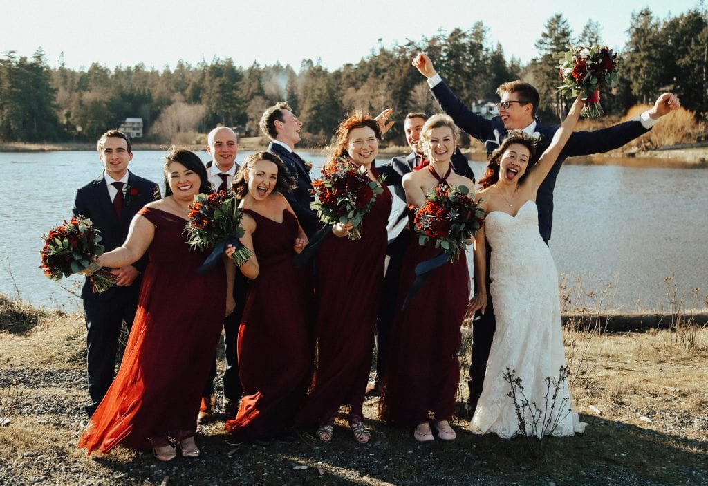Steal of a Wedding bridal party celebrating on beach