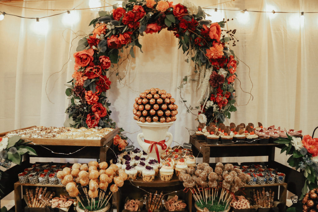 Steal of a Wedding dessert table with cake pops, cookies, chocolates