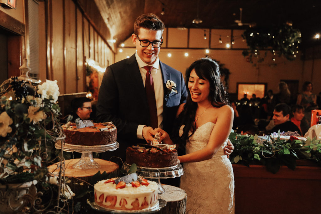 Steal of a Wedding bride and groom cutting their wedding cakes from Murchie's Victoria Cafe