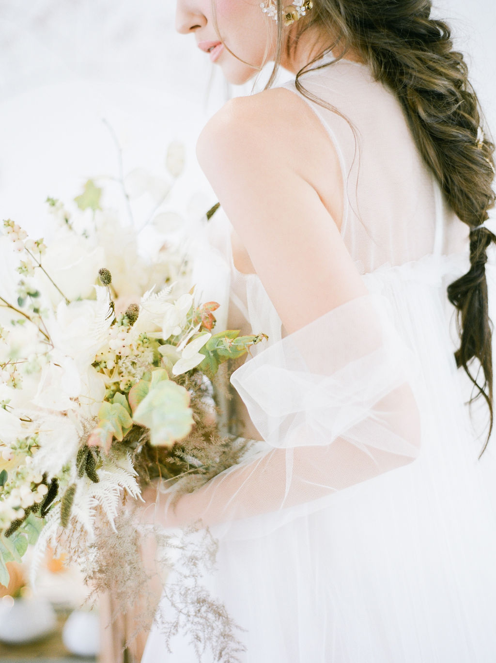 Vera Wang bride holds white bouquet by Simply Sweet Photography Vancouver