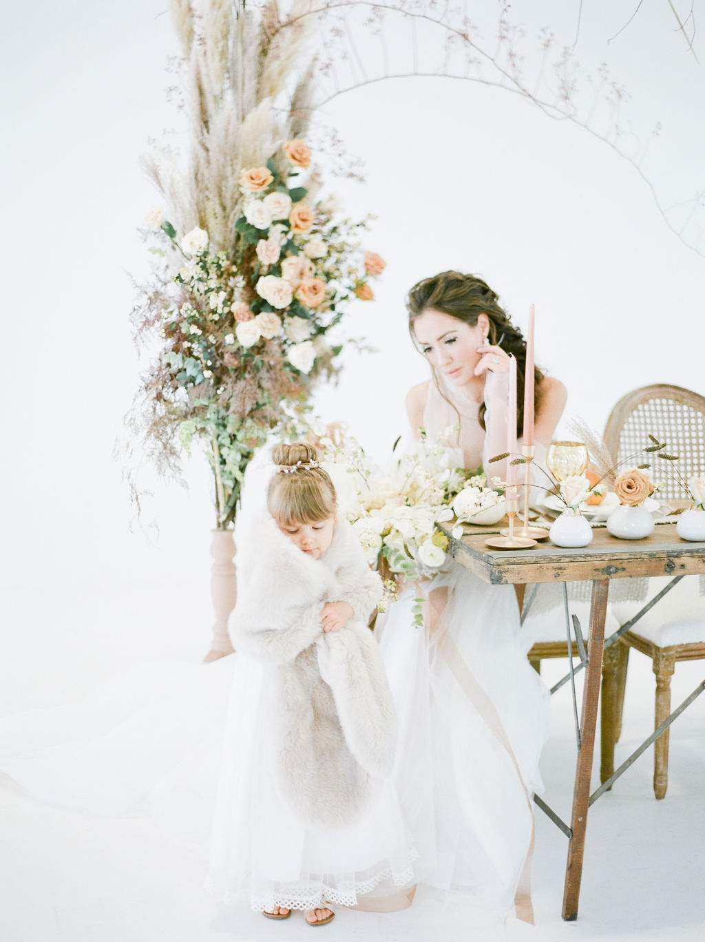 Simply sweet bride surrounded by roses and pampas grass