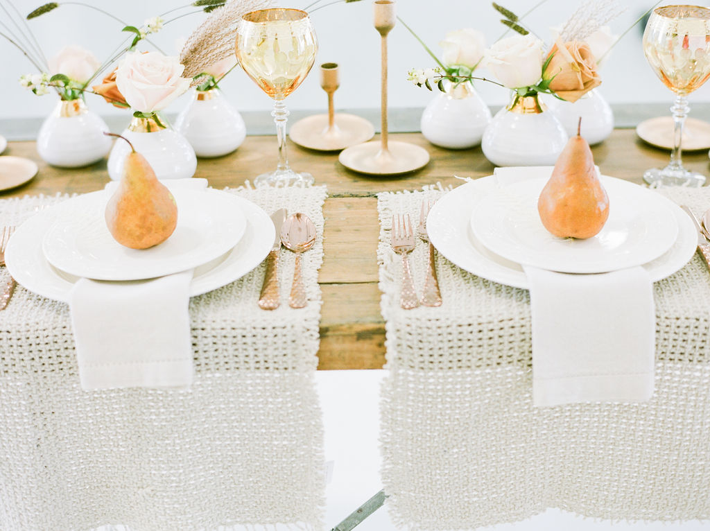 Sweetheart table featuring golden pears, white linens and roses by Deborah Lee Designs Vancouver