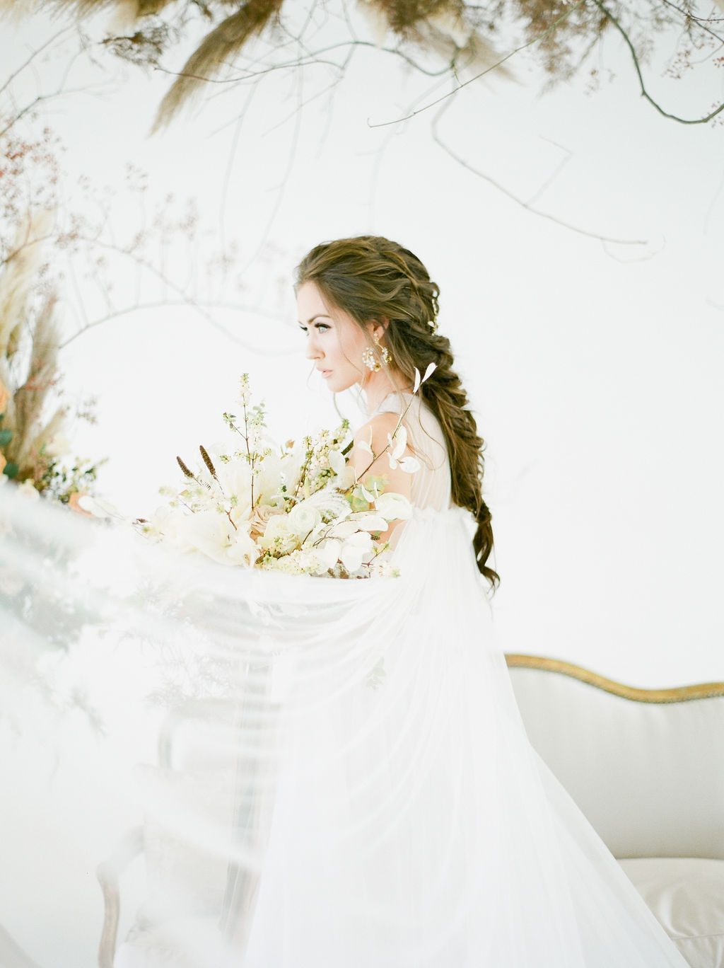 Bride with bridal braid and bouquet at Airside Spaces in Vancouver