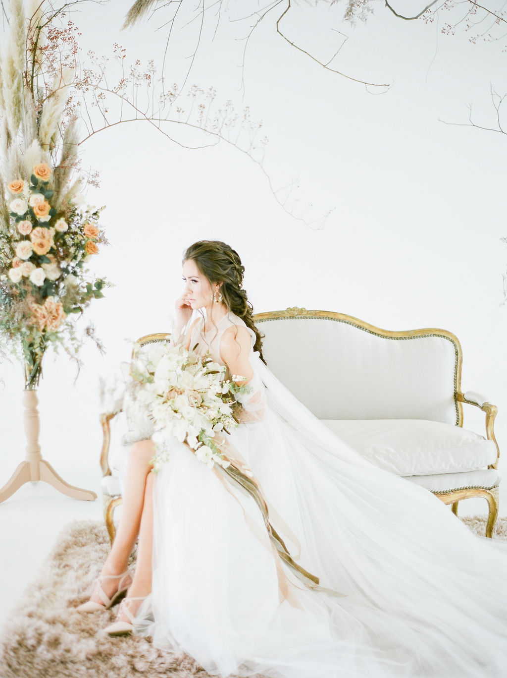 Vera Wang Bride on white settee in white space