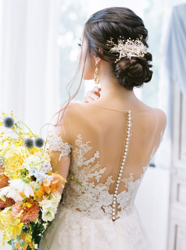 Back of Wedding Gown with Button by Niki Xie Photography Vancouver