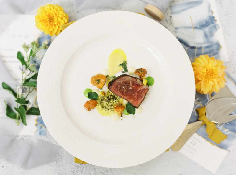 Colourful Dish by Neue Catering with Marigold Yellow Flowers on Dusty Blue Linen Vancouver