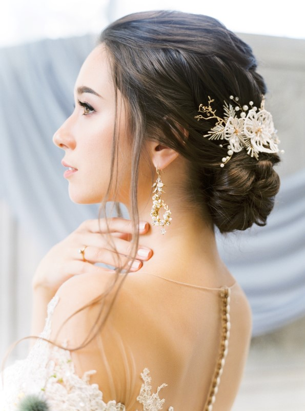 Bride with hair jewelery in swept up do with earrings by Momo Liu Makeup Vancouver