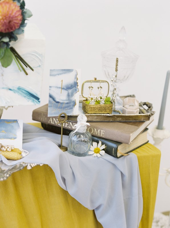 Silver Tray on Marigold Yellow Linen with Stack of Books and Decor