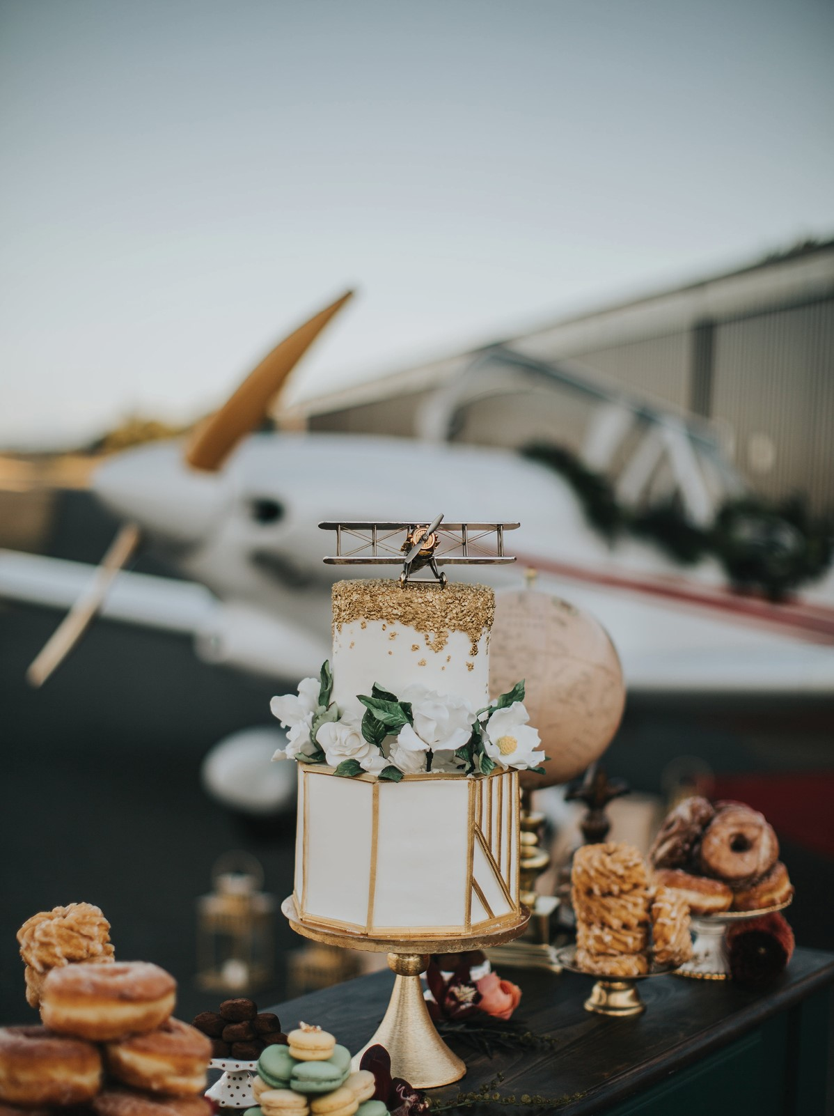 White and Gold Cake with airplane topper by Passion for Cakes