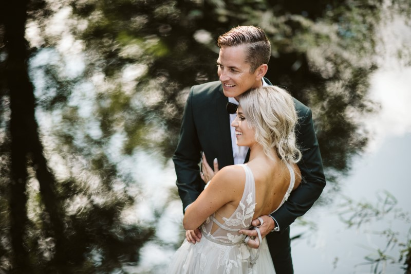 Wedding couple laughing by Erin Wallis Photography