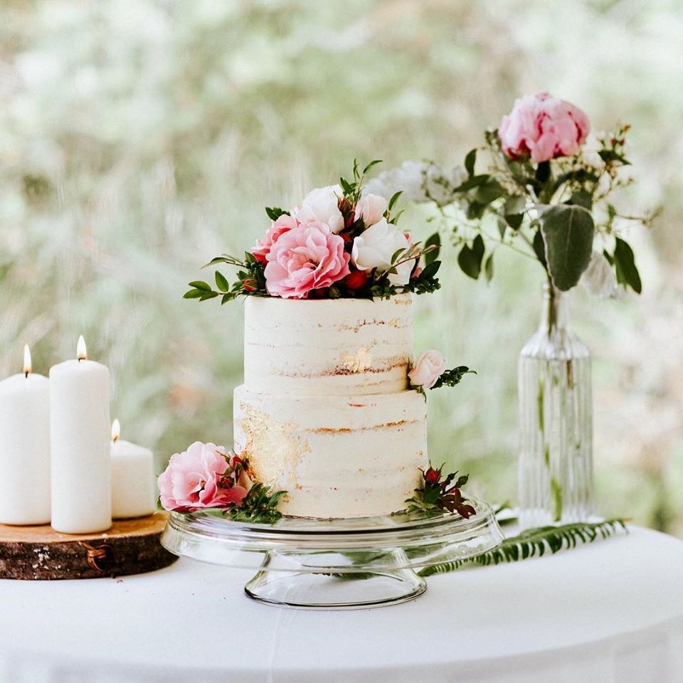 Naked Cake with White Icing and Pink Roses by Tofino Cake Studio