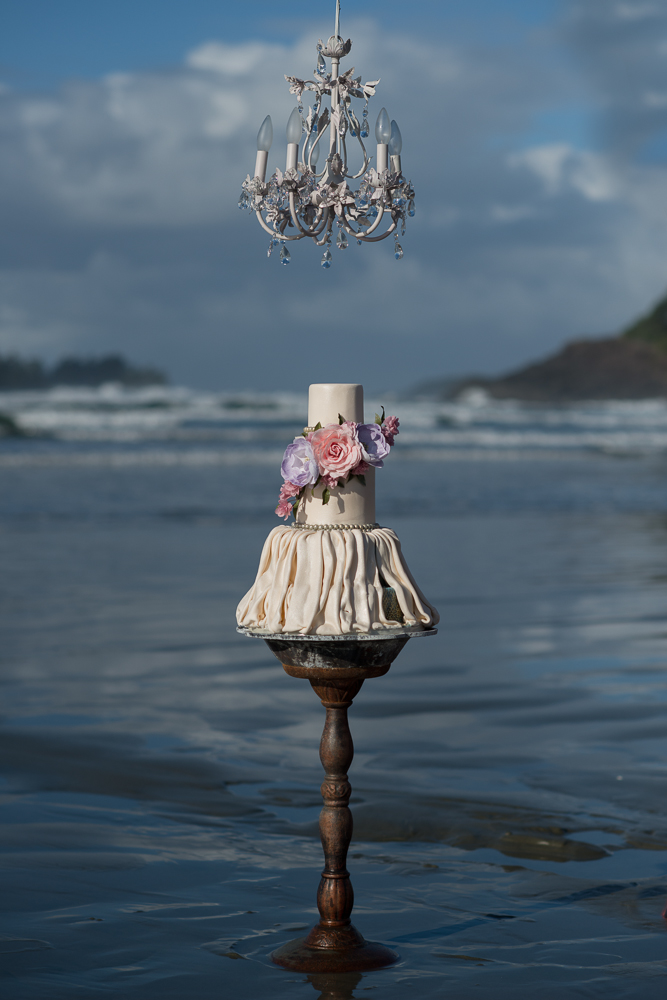 Cake Sitting in Ocean by Coastal Cake Company and Erin Wallis Photography at Long Beach Lodge Resort