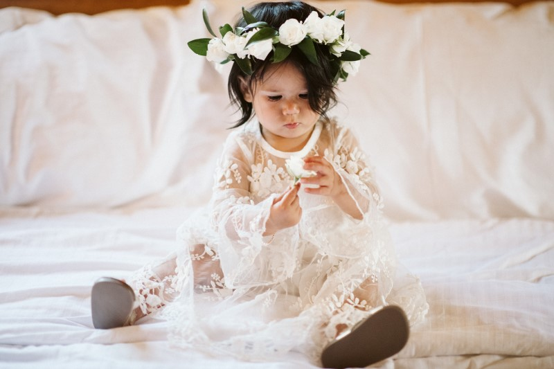 Wedding in the Woods flower girl with white rose head wreath by Erin Wallis Photography