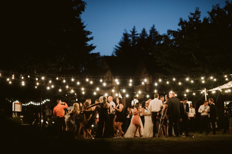 Wedding in the Woods guests dance under the stars and lights on Vancouver Island