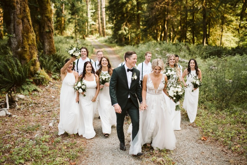 Wedding Party walks down path in the woods on Vancouver Island