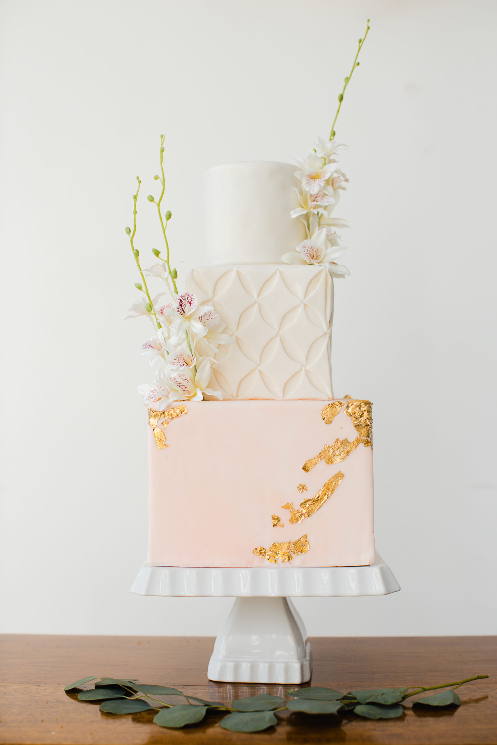 Peach and White Stacked Cake with Gold Emblossing and White Flowers by Schur to Please Vancouver Island