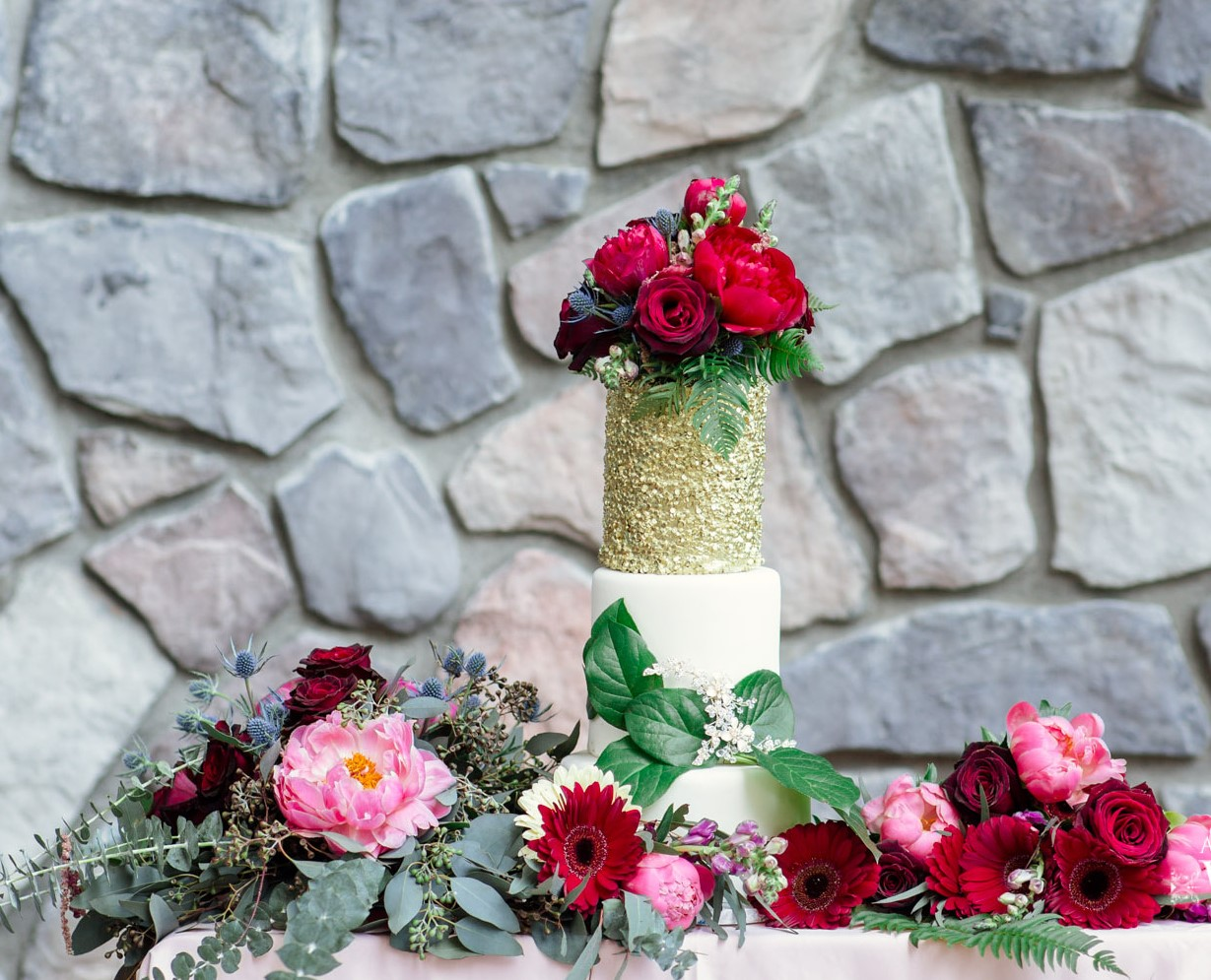 Wedding Cake surrounded by pink and red roses Thrifty Foods
