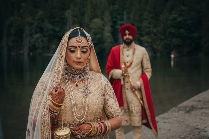 Coastal Luxury Indian Wedding Newlyweds beside lake near Vancouver