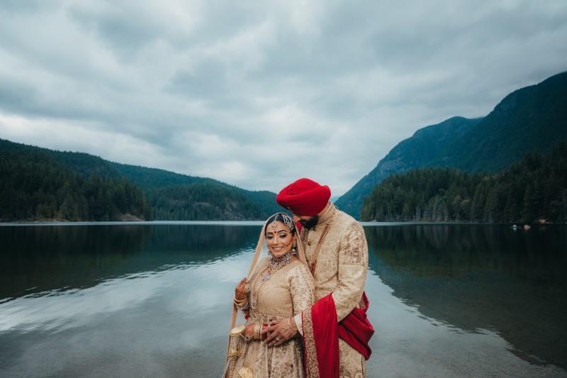 Coastal Luxury Indian Wedding bride and groom by Rocky Mountain Lake by Dreamfinity Studio