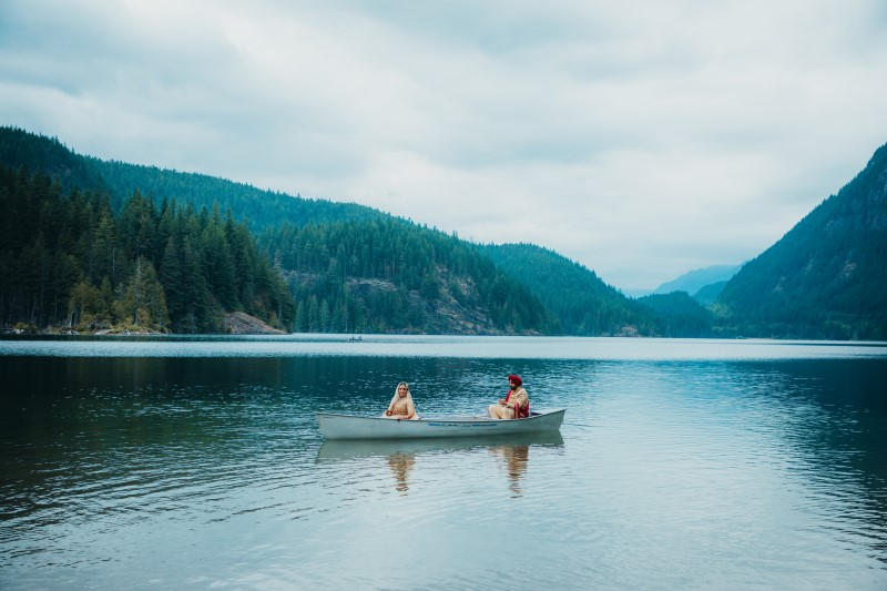 Indian Bride and Groom in Canoe in the Rocky Mountains