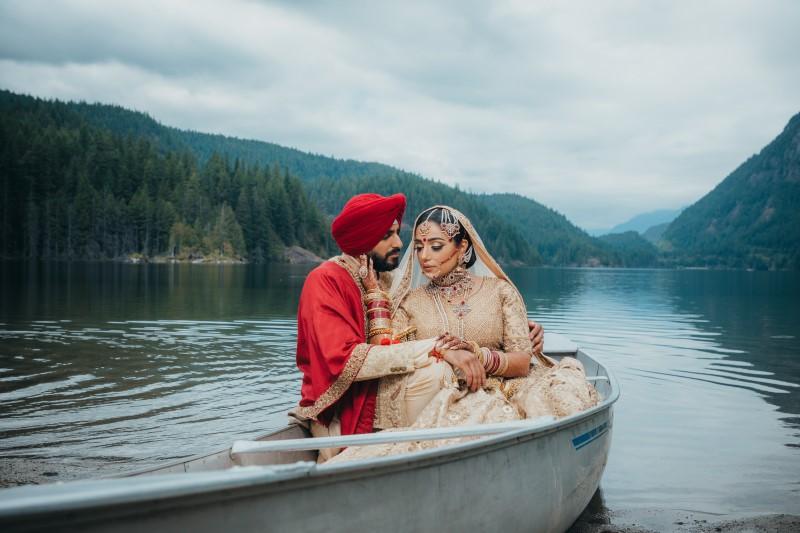 Newlywed Indian Couple in Canoe West Coast Weddings Magazine