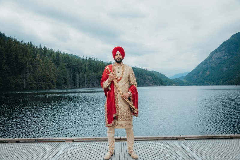 Indian Groom and Kirpan in front of Rocky Mountain Lake by Dreamfinity Studios