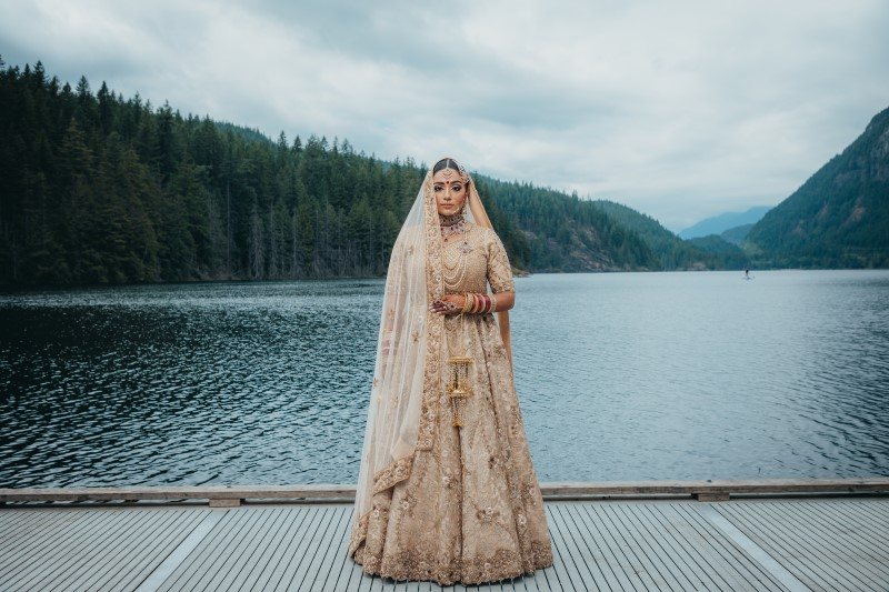 Bride wears Blush Saree in front of Rocky Mountain Lake near Vancouver
