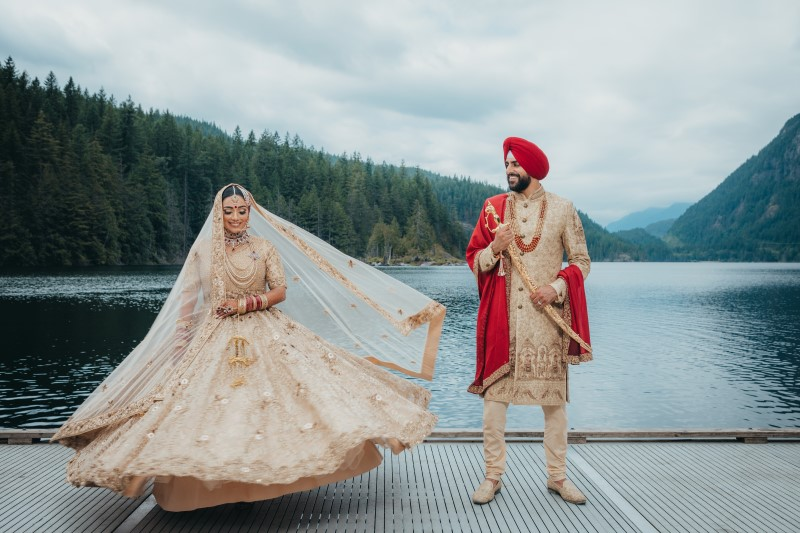 Bride and Groom in traditional Indian wedding finery by Dreamfinity Studios