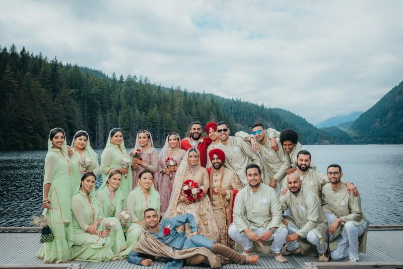 Coastal Luxury Indian Wedding party on lake dock by West Coast Weddings Magazine