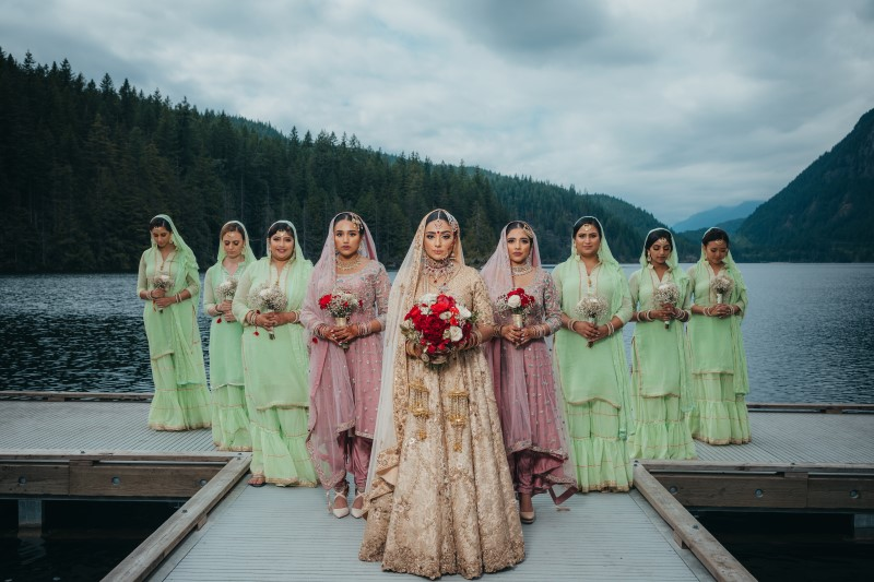 Coastal Luxury Indian Bride and Bridemaids in Blush and Green Sarees by Vivah Collection