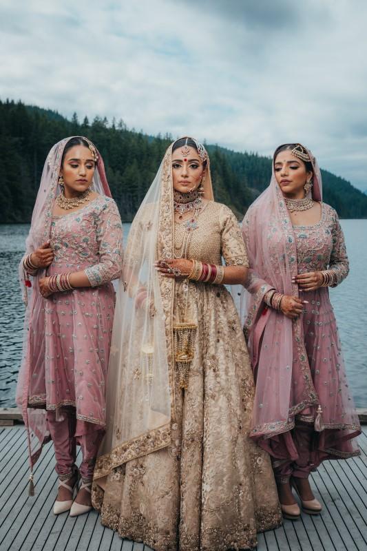 Indian Bride and Bridesmaids in Blush Sarees by Pristine Allure Studio