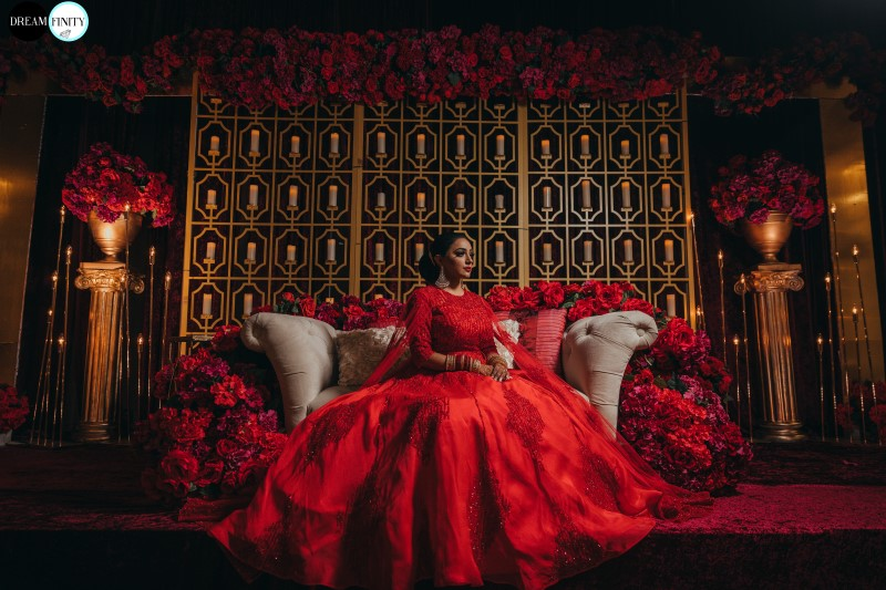 Coastal Luxury Bride in scarlet red gown by Vivah Collection