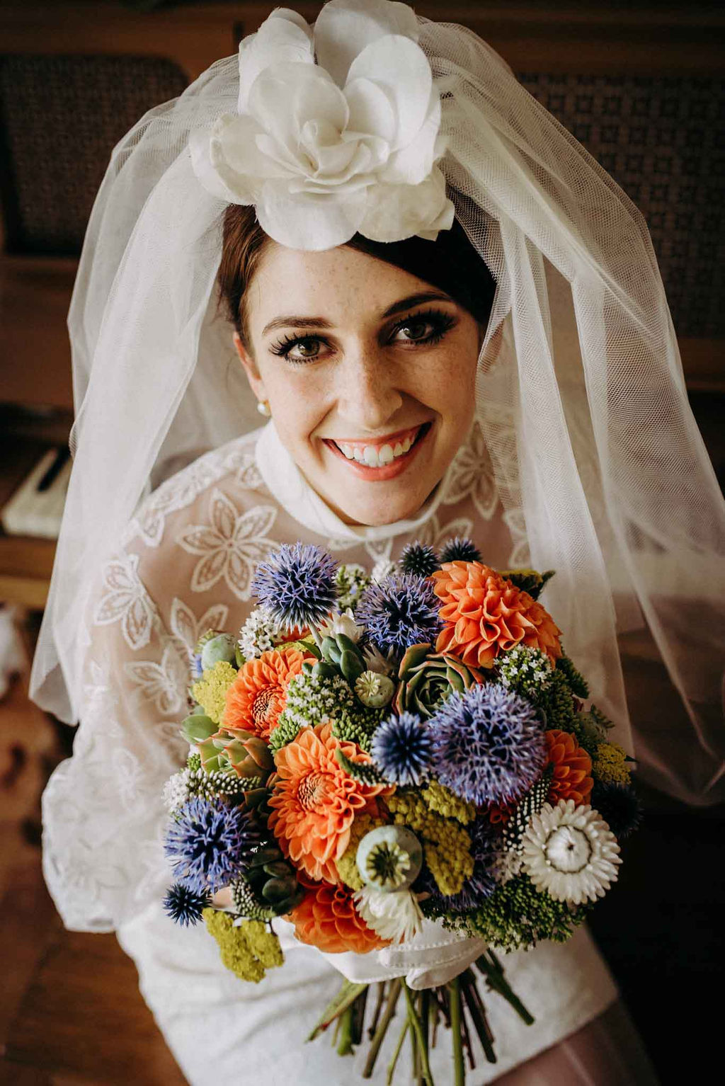 Vintage Bride Holds Smokey Blue and Orange Brides Bouquet by Little Bee Blooms
