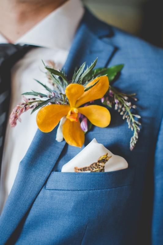 Orange Boutonnière on Blue Suit by Hughs Clothing