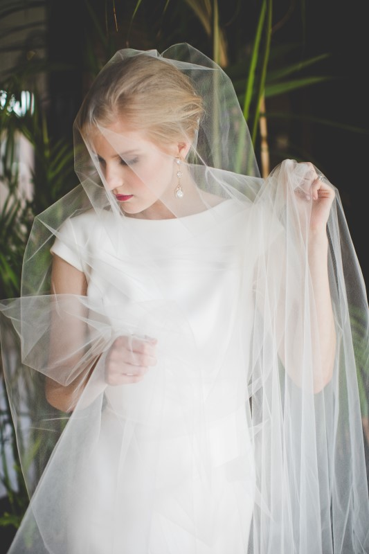 Bride covered in veil at The Fairmont Empress by Dragonflight PHotography