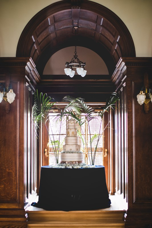 White Multi Layered Wedding Cake by Fairmont Empress chefs sits in window