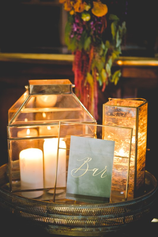 Candles inside of glass prisms on glass table by DragonFlight PHotography and The Good Party