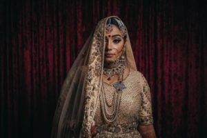 Indian Bride hides half her face behind luxurious veil by Dreamfinity Studios