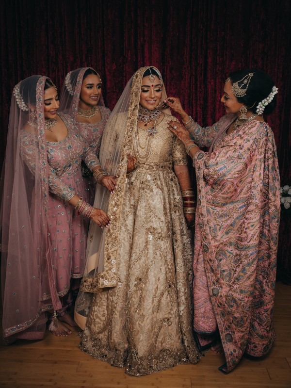 Flawless Bridal Fusion Indian Bride with mother and bridesmaids by Vivah Collection