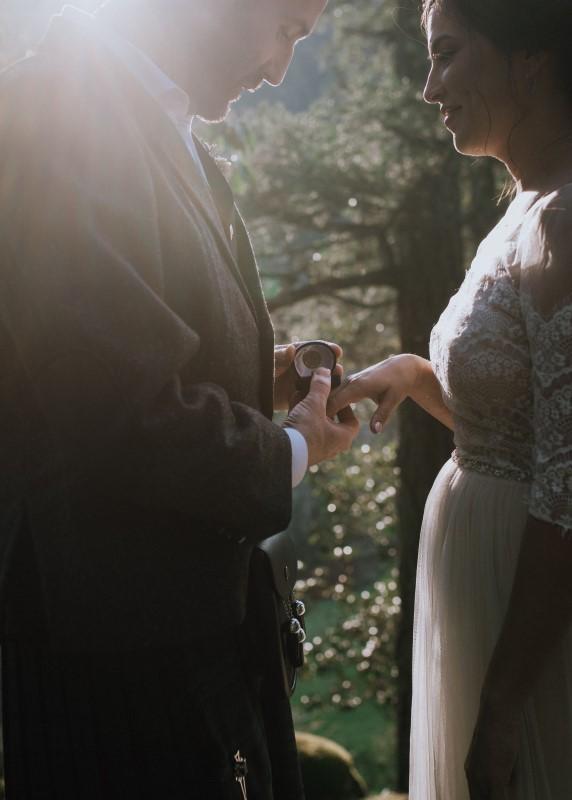 Wedding Couple Exchange Rings at Vancouver Island Wedding