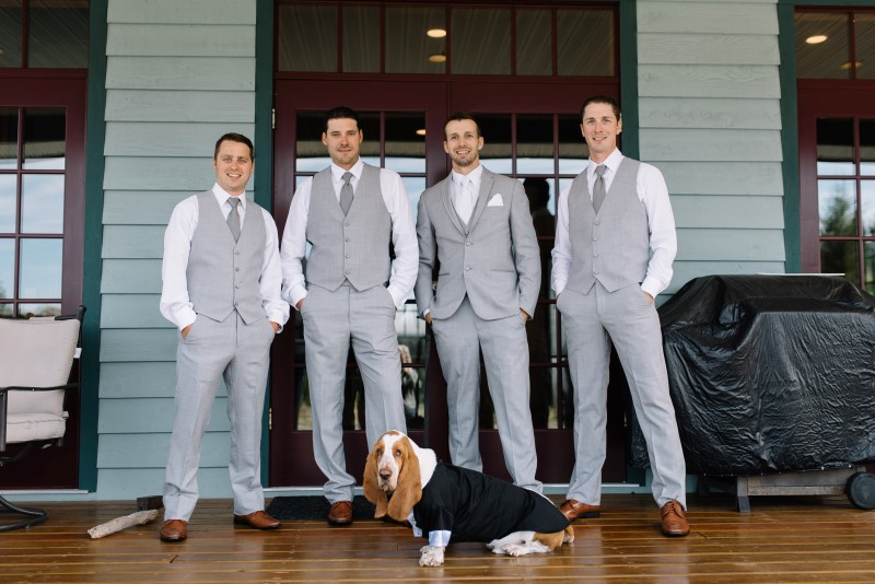 Groomsmen with hound dog wearing suits by Moores Clothing for Men on Vancouver Island