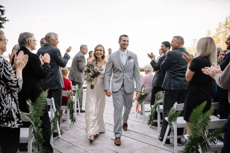 Seaside Romance Wedding Couple Leaving Ceremony at Telegraph Cove on Vancouver Island