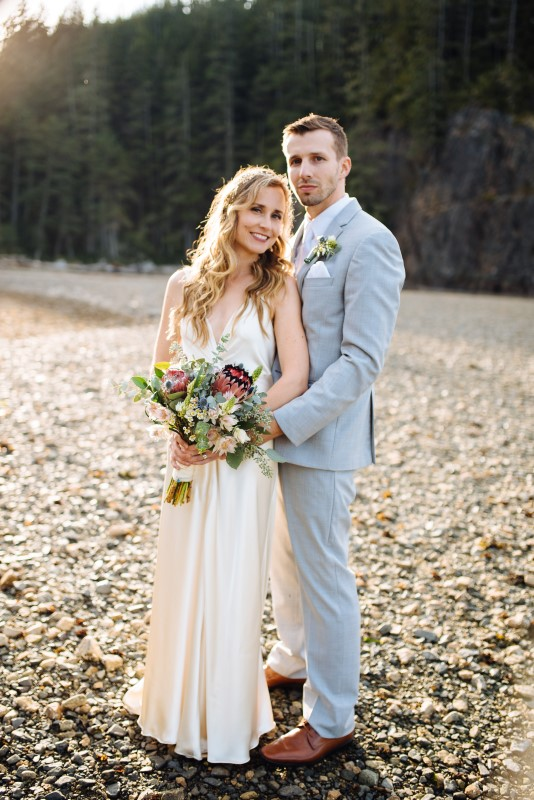 Newlyweds Pose on Vancouver Island, Bridal Gown by The White Peony