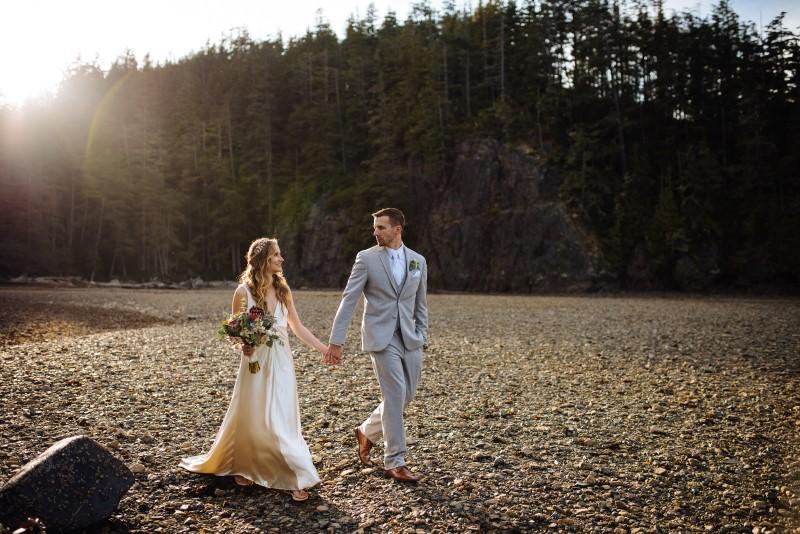 Seaside Romance Newlyweds Holding Hands by Lavish Engagements