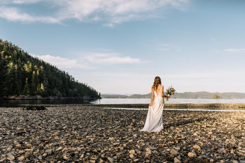 Seaside Romance Bride Walking Along Stony Beach by Masika May Photography