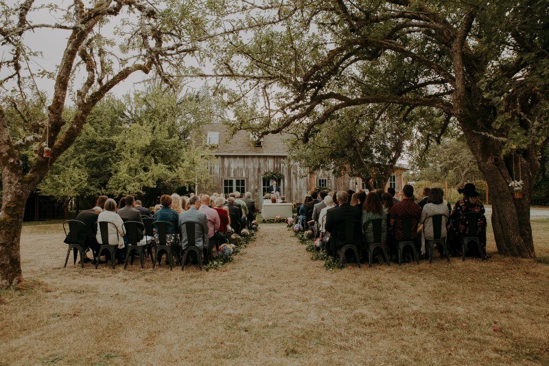 Charming Farm Wedding Ceremony Outdoors by Wood House at Bilston Creek Farm on Vancouver Island