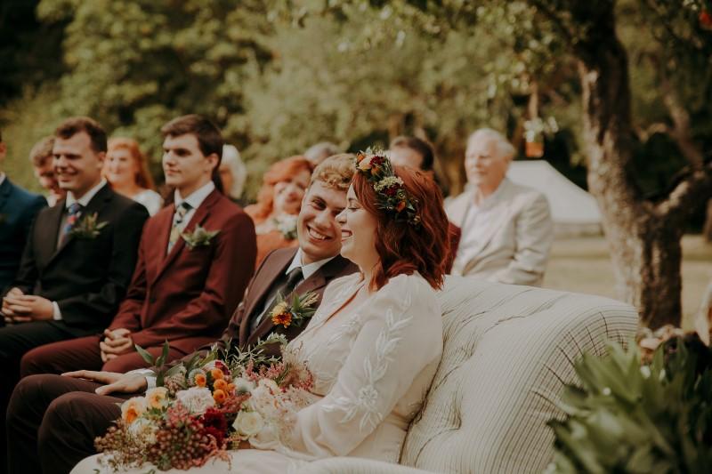 Wedding Couple on settee during ceremony vows at Bilston Creek Farm LumiPhoto