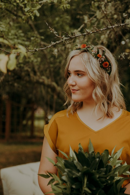 Bridesmaid with flower crown and yellow blouse at Vancouver Island Wedding LumiPhoto
